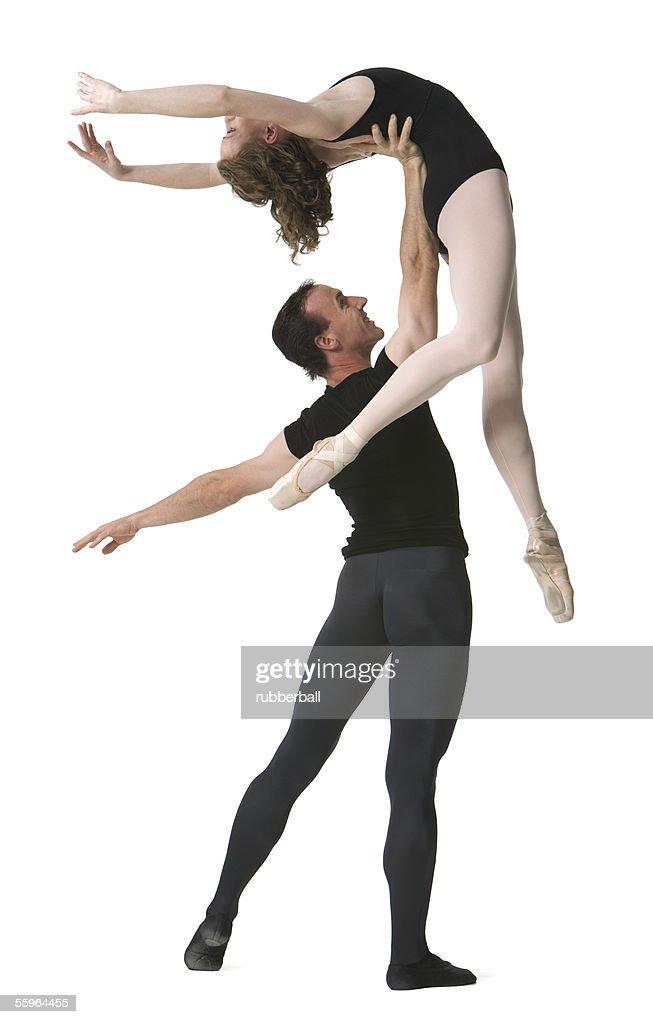 Male ballet dancer supporting a female ballerina