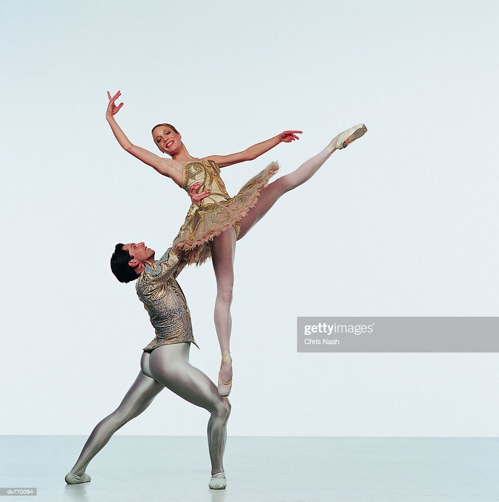 Male Ballet Dancer Supporting Female Ballerina Stock Photo | Getty ...