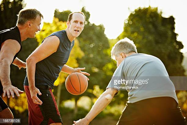 Male basketball player dribbling ball on court