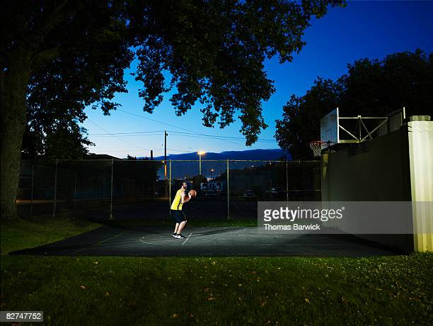 Male basketball player on outdoor basketball court