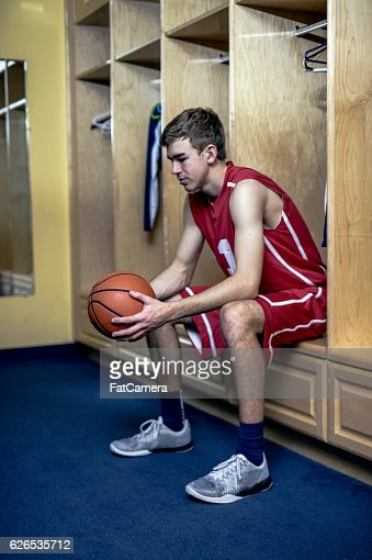 Male basketball star thinking deeply before the game starts