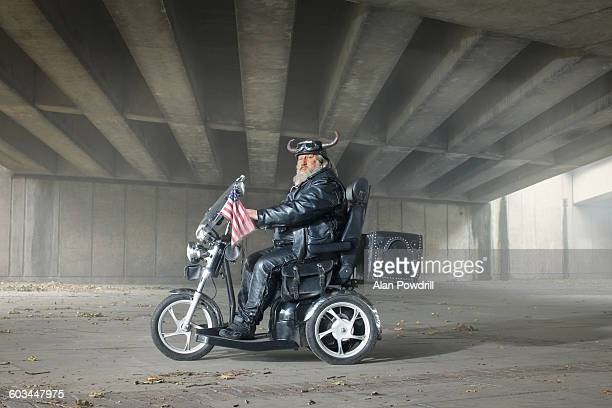 Male biker on scooter with American flag