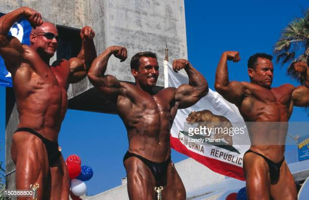 Male body builders posing at Muscle Beach, Venice.