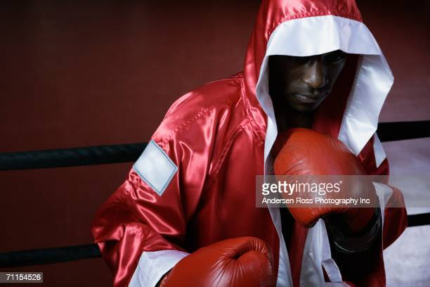 Male boxer in robe ready to fight