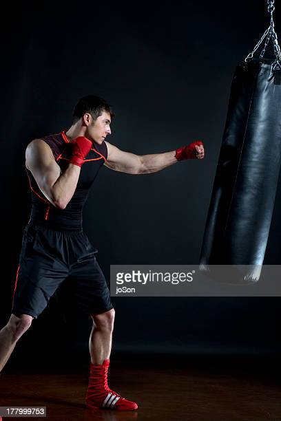 Male boxer training with heavy bag
