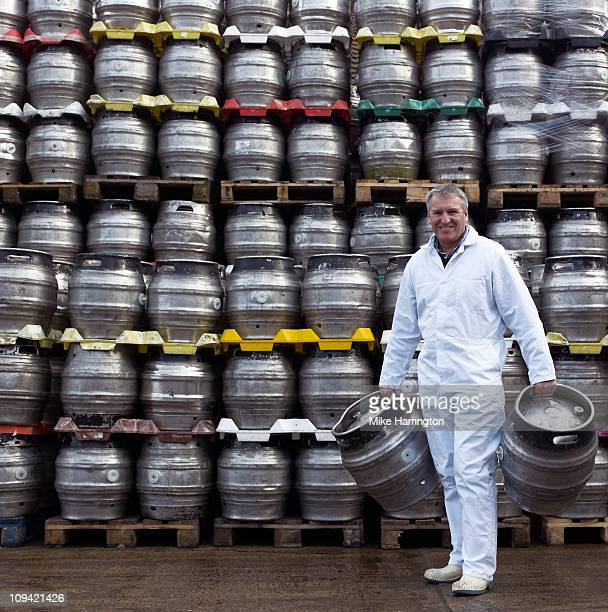Male Brewer Carrying Kegs