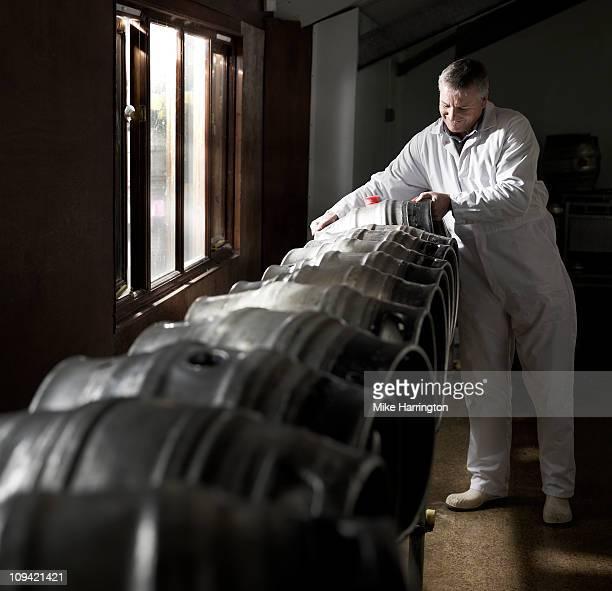 Male Brewer Lifting Beer Keg