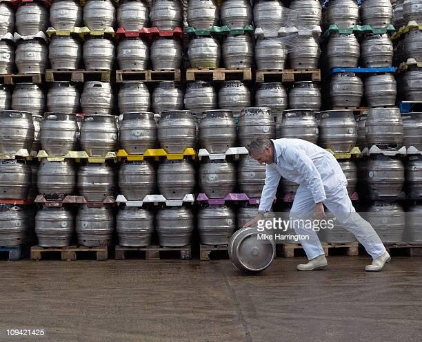 Male Brewer Pushing Keg