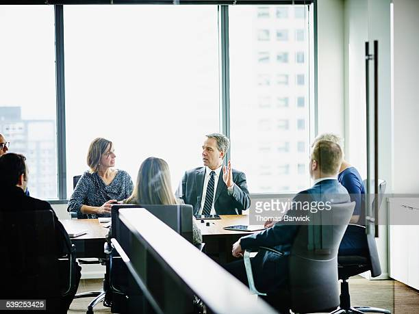 Male business executive leading project discussion
