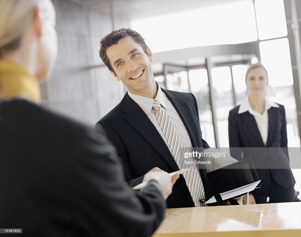 Male business traveler at check in