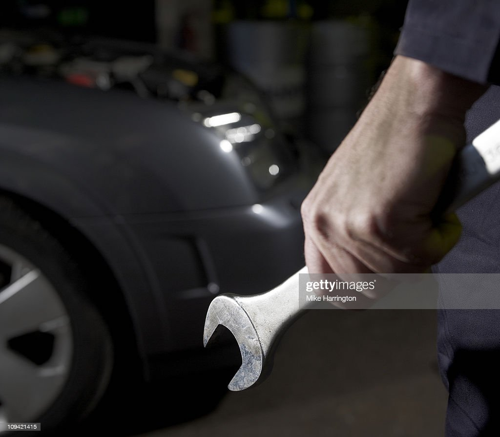 Male Car Mechanic Holding Spanner