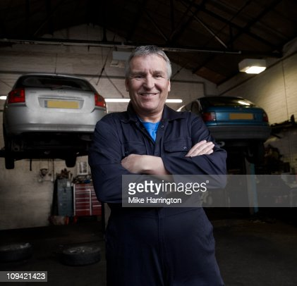 Male Car Mechanic Standing in Garage