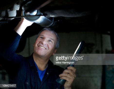 Male Car Mechanic Working On A Car