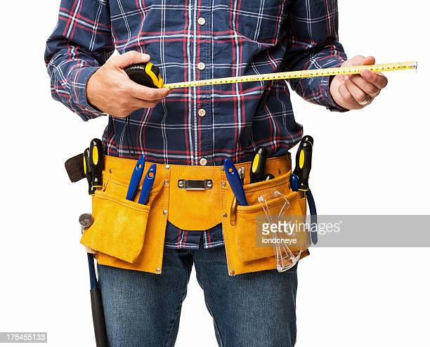 Male Carpenter Holding a Tape Measure - Isolated