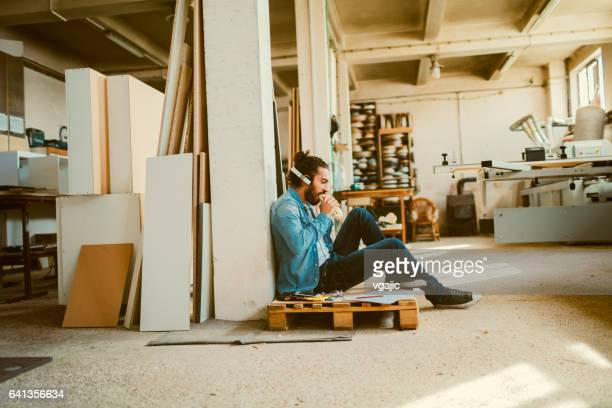 Male Carpenter Working In His Workshop