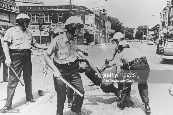 Male carried away by police during riots Baltimore Maryland 1968