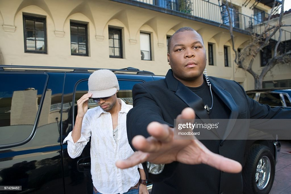 Male celebrity and bodyguard : Stock Photo