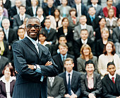 Male CEO Standing in Front of a Large Group of Business People