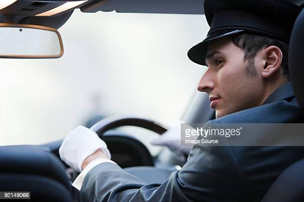 Male chauffeur driving