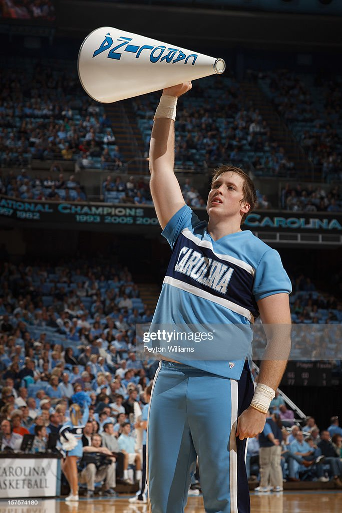A male cheerleader of the North Carolina Tar Heels holds a megaphone and cheers fans while playing the Alabama Birmingham Blazers on December 01, 2012 at the Dean E. Smith Center in Chapel Hill, North Carolina. North Carolina won 102-84.