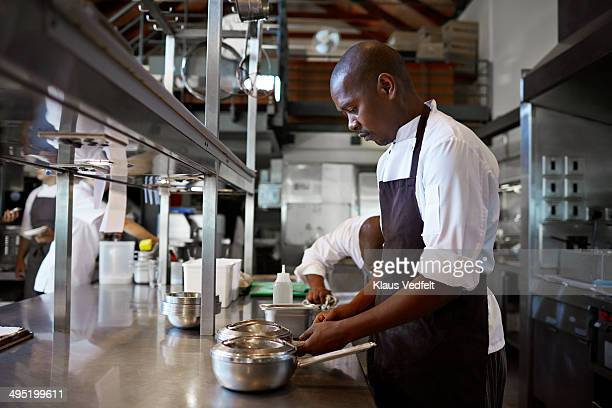 Male chef preparing fonts at restaurant