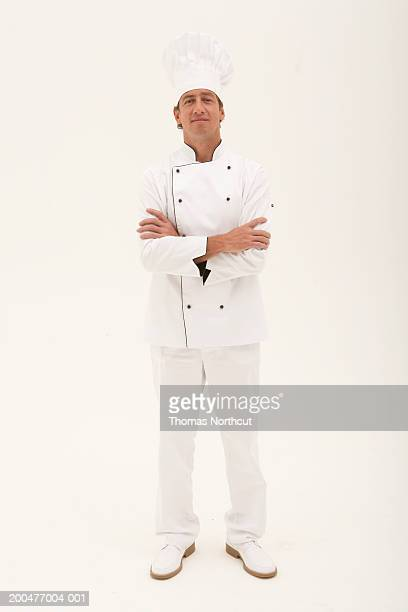 Male chef standing with arms crossed, portrait