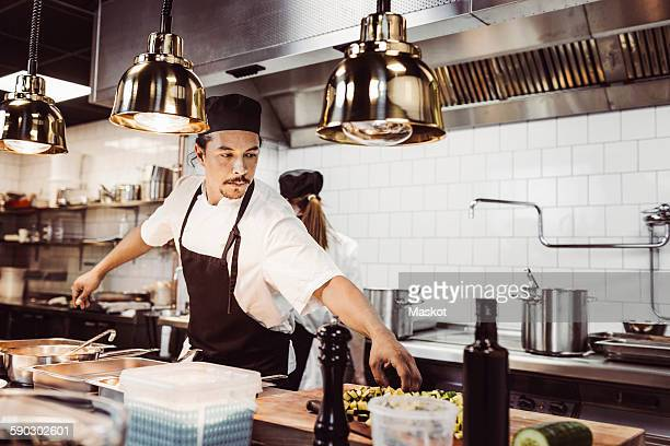 Male chef working at commercial kitchen counter