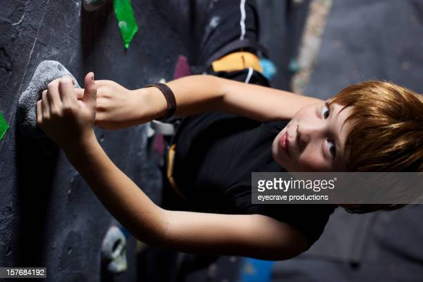 male child rock climber climbing gym