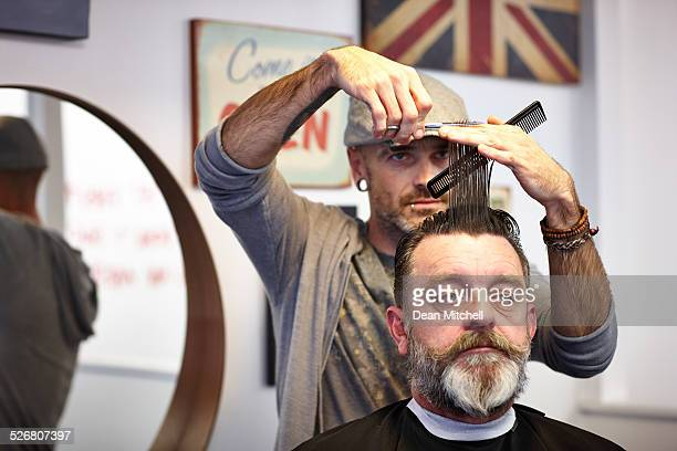 Male client getting haircut from hairstylist