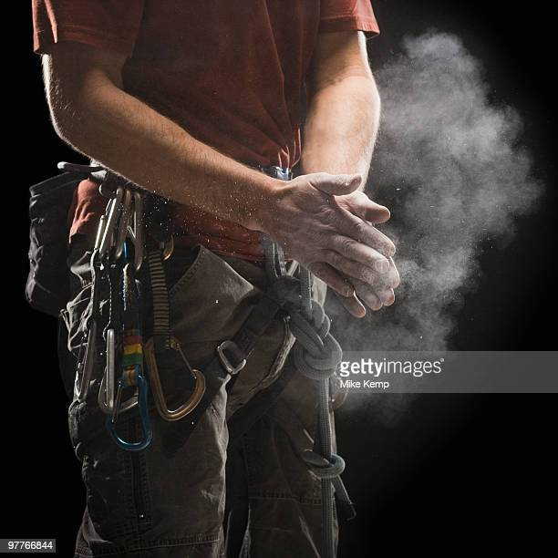 Male climber applying chalk to hands