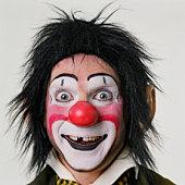 Male clown smiling, close-up, portrait