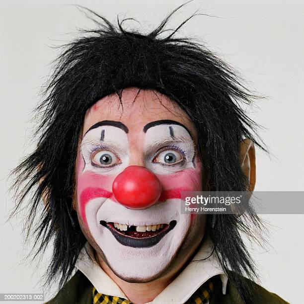 Male clown smiling, close-up, portrait
