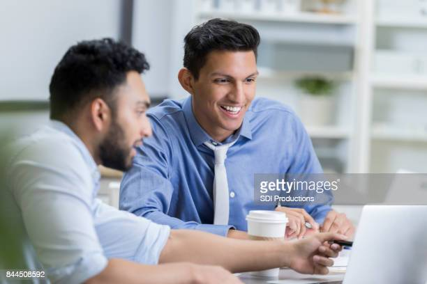 Male colleagues collaborate about current projects