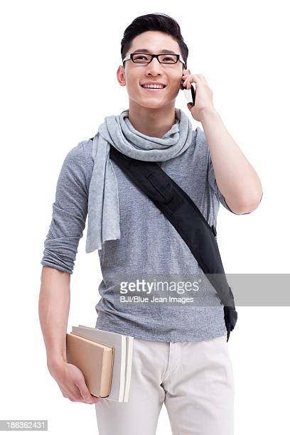 Male college student on the phone