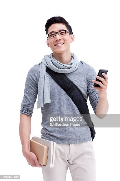 Male college student with mobile phone