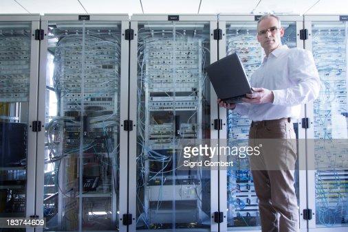 Male computer technician in server room