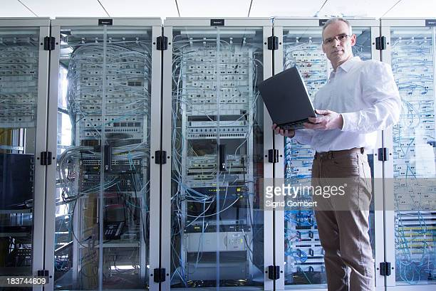 Male computer technician in server room