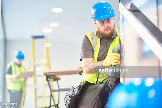 male construction worker fitting office handrails