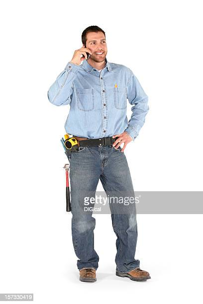 Male contractor talking on the phone