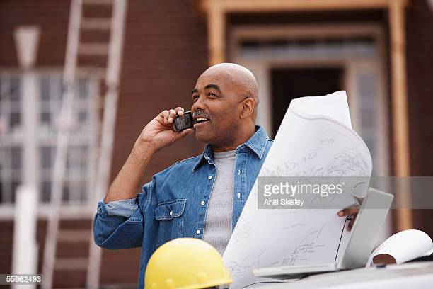 Male contractor using mobile phone