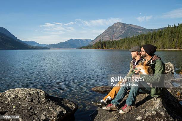 Male couple and their dog at a lake