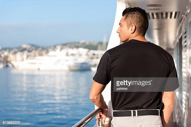 Male crew member looking from yacht boat