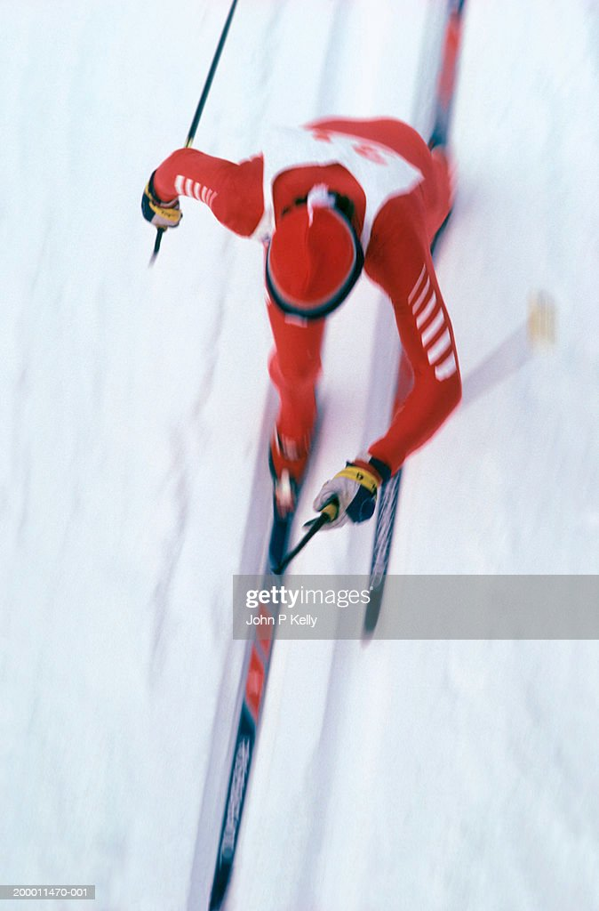 Male cross country ski racer, overhead view (blurred motion) : Stock Photo