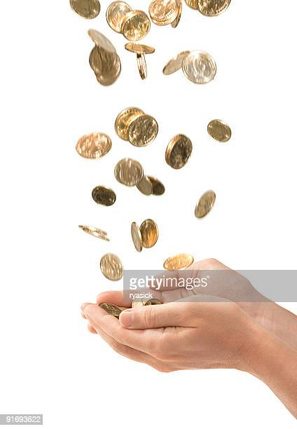 Male Cupped Hands Catching Falling Gold Coins Isolated on White