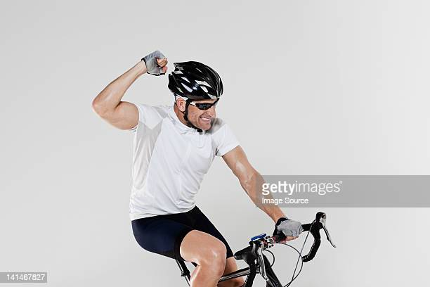 Male cyclist cheering