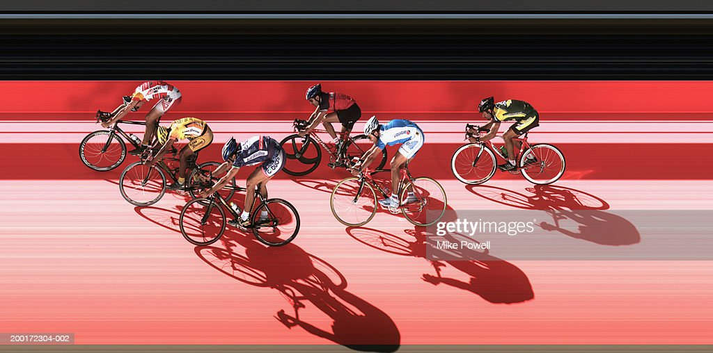 Male cyclist racing in velodrome