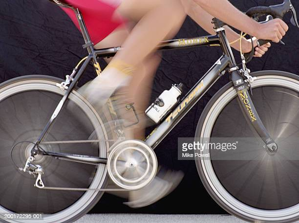 Male cyclist riding bicycle (blurred motion)