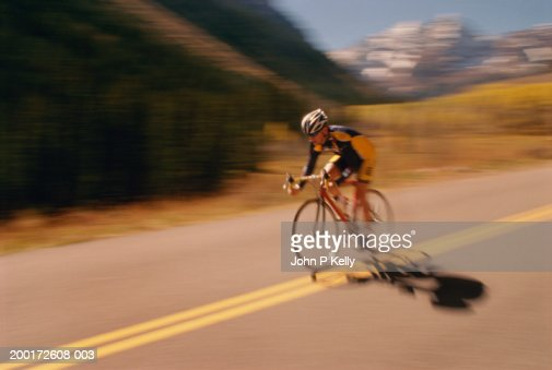 Male  cyclist riding bike on road (blurred motion) : Stock Photo