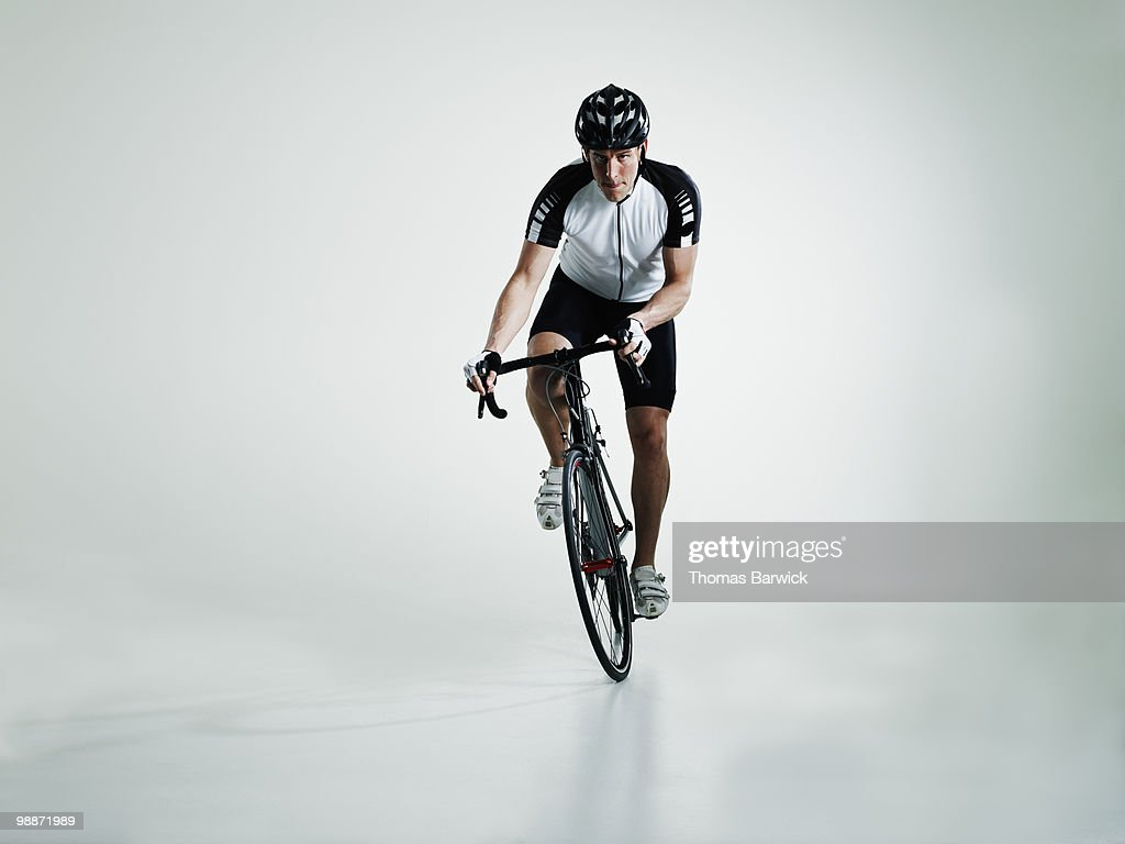Male cyclist standing in pedals riding bike