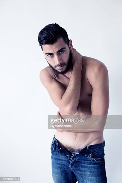 Male dancer in open blue jeans
